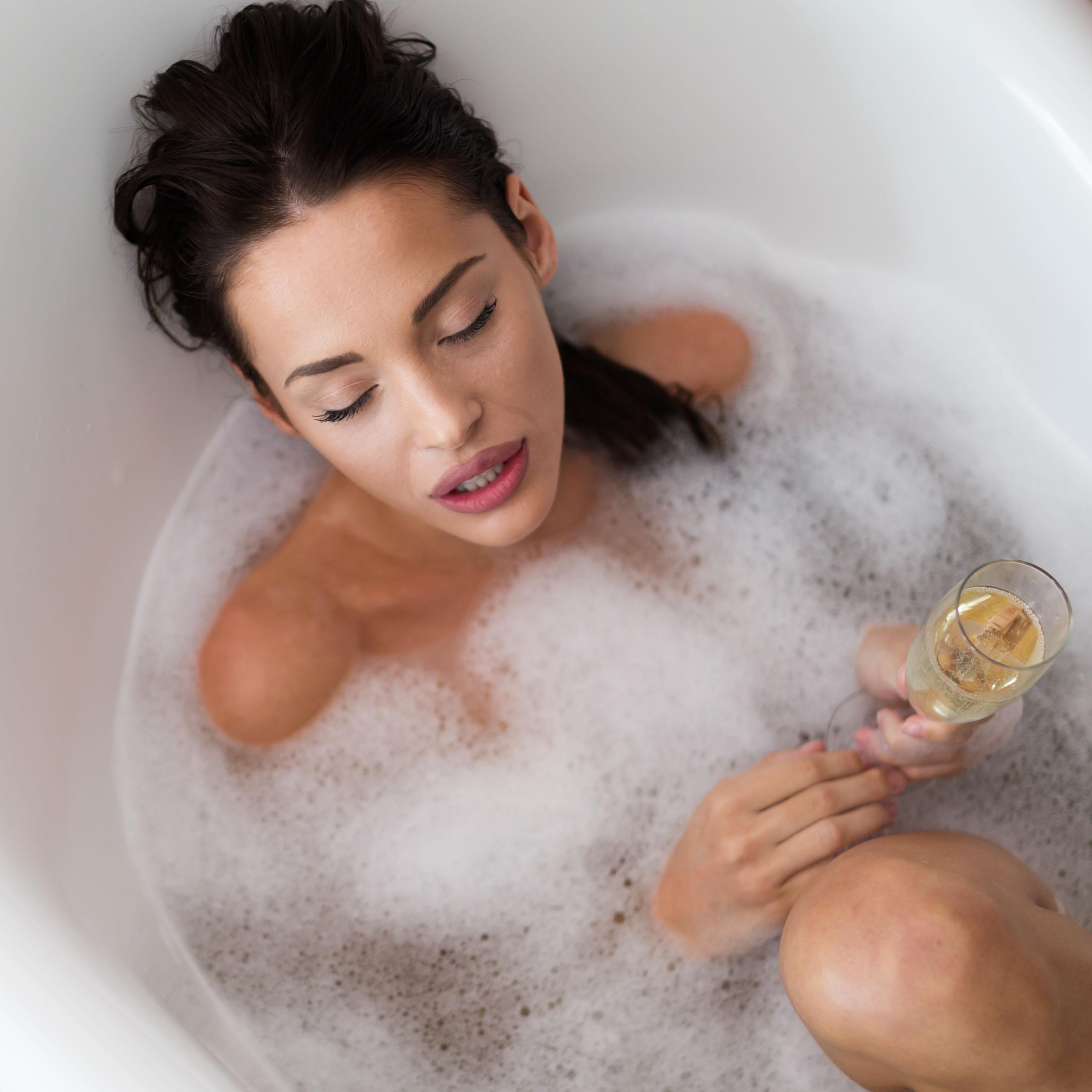 Beautiful woman having a bubble bath